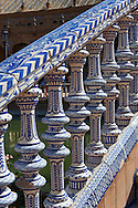Tiled stair balistrades of the Plaza de Espana in Seville built in 1928 for the Ibero-American Exposition of 1929, Seville Spain . The Royal Alcázars of Seville (al-Qasr al-Muriq ) or Alcázar of Seville, is a royal palace in Seville, Spain. It was built by Castilian Christians on the site of an Abbadid Muslim alcazar, or residential fortress.The fortress was destroyed after the Christian conquest of Seville The palace is a preeminent example of Mudéjar architecture in the Iberian Peninsula but features Gothic, Renaissance and Romanesque design elements from previous stages of construction. The upper storeys of the Alcázar are still occupied by the royal family when they are in Seville. <br /> <br /> Visit our SPAIN HISTORIC PLACES PHOTO COLLECTIONS for more photos to download or buy as wall art prints https://funkystock.photoshelter.com/gallery-collection/Pictures-Images-of-Spain-Spanish-Historical-Archaeology-Sites-Museum-Antiquities/C0000EUVhLC3Nbgw <br /> .<br /> Visit our MEDIEVAL PHOTO COLLECTIONS for more   photos  to download or buy as prints https://funkystock.photoshelter.com/gallery-collection/Medieval-Middle-Ages-Historic-Places-Arcaeological-Sites-Pictures-Images-of/C0000B5ZA54_WD0s