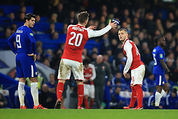 10 January 2018 -  EFL Cup - Semi Final (1st Leg) - Chelsea v Arsenal - Jack Wilshere of Arsenal throws the captains armband to Shkodran Mustafi as he is forced off with an injury - Photo: Marc Atkins/Offside