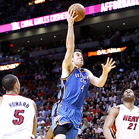16 March 2011: Oklahoma City Thunder power forward Nick Collison (4) goes for the layup during the Oklahoma City Thunder 96-85 victory over the Miami Heat at the AmericanAirlines Arena, Miami, Florida, USA.