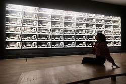 © Licensed to London News Pictures. 10/03/2020. Gallery staff view a large artwork titled Sixty Last Suppers,1986, by artist Andy Warhol at an exhibition showing at the Tate Modern. London, UK. Photo credit: Ray Tang/LNP