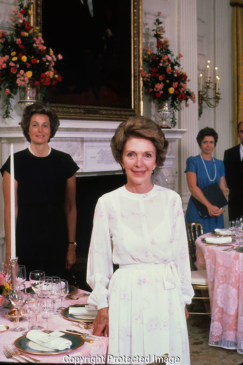 First Lady Nancy Reagan and her staff (Muffy Brandon on left and Sheila Tate) pose in the state dining room before  a state dinner for Anwar Sadat in August 1981,  This assignment was for a story on a state dinner for  TIME Magazine...Photograph by Dennis Brack bb24