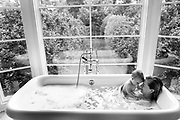 A mother and child are photographed during bathtime in the Hamptons, NY.