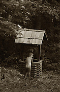 A child plays but a well in rural Arkansas while on vacation near the Ozarks.