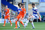 Blackpool's Chris Basham passing the ball past Queens Park Rangers Clint Hill . Skybet football league championship match , Queens Park Rangers v Blackpool at Loftus Road in London  on Saturday 29th March 2014.<br /> pic by John Fletcher, Andrew Orchard sports photography.