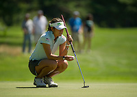 Jean Chua lines up her putt on the 9th hole during the LPGA Symetra Tour at Beaver Meadow Golf Course Friday afternoon.  (Karen Bobotas/for the Concord Monitor)