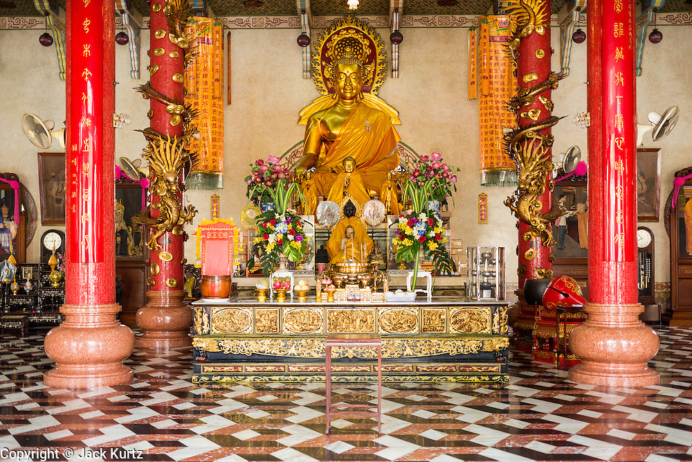 06 JUNE 2013 - BANGKOK, THAILAND:   The main Buddha statue in Wat Bhoman Khunaram. Wat Bhoman Khunaram on Sathu Pradit Road in Bangkok, is considered the most beautiful Chinese temple in Thailand. The temple was built in a blend of Thai, Chinese and Tibetan styles. It was built in the 1959 and is a Mahayana Buddhist temple (most Thais are Theravada Buddihists). There is a monastery on the temple grounds and many boys go to the temple to become monks and learn Chinese Buddhist rituals and Chinese language.      PHOTO BY JACK KURTZ