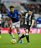 Football - 2019 / 2020 Premier League - Newcastle United vs. Everton<br /> <br /> Federico Fernandez of Newcastle United vies with Dominic Calvert-lewin of Everton, at St James' Park Stadium.<br /> <br /> COLORSPORT/BRUCE WHITE