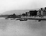 A line-up of currachs at the start of the Seine Boat Competition at the Dingle Regatta<br /> 22/08/1976
