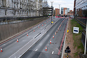 A38 in Birmingham city centre is virtually deserted with no cars using this main road system due to the Coronavirus outbreak on 31st March 2020 in Birmingham, England, United Kingdom. Following government advice most people are staying at home leaving the streets quiet, empty and eerie. Coronavirus or Covid-19 is a new respiratory illness that has not previously been seen in humans. While much or Europe has been placed into lockdown, the UK government has announced more stringent rules as part of their long term strategy, and in particular social distancing.