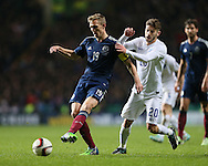 Scotland's Darren Fletcher tussles with England's Adam Lallana<br /> <br /> - International Friendly - Scotland vs England- Celtic Park - Glasgow - Scotland - 18th November 2014  - Picture David Klein/Sportimage