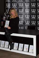 © Licensed to London News Pictures. 24/11/2011. London, UK. Academy Award-winning actress Goldie Hawn pictured in the Piccadilly branch of Waterstones promoting her new book, 10 Mindful Minutes, which was released on March 1st. : James Gourley/LNP