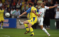 Photo: Rich Eaton.<br /> <br /> Torquay United v Norwich City. Carling Cup. 23/08/2006. Mickey Evans (left) of Torquay shields the ball from Norwichs Craig Fleming