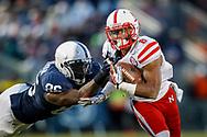 Ameer Abdullah tries to shake a defender at Penn State on Nov. 23, 2013. © Aaron Babcock