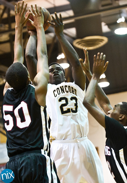 Concord's Xavier Stywall goes up for a shot against Harding University High School's Steven Burrough (50) during the second round of NCHSAA 3-A Playoffs Wednesday night. Concord won 66-58 to advance. The Spiders will play conference rival Hickory Ridge Friday night at Concord High School. (Photo by James Nix)