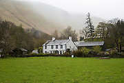 Traditional stone farmhouse at Howtown, Ullswater, Cumbria, England, UK