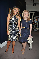 Left to right,  and her mother MARIANNA VARDINOYIANNIS Goodwill Ambassador of UNESCO at a party to celebrate the publication of Elena Makri Liberis's book 'Every Month, Same day' held at Sotheby's, 34-35 New Bond Street, London on 5th May 2009.