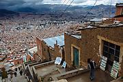 At the highest area of El Alto, beside of La Paz, Bolivia, the Cholita's wrestling show takes place every Sunday, in El Alto, Bolivia, February 19, 2012.<br /> SPANISH: Escarpadas escaleras sirven para llegar al edificio Multifuncional de El Alto, lugar donde cada domingo se llevan acabo las presentaciones de lucha libre de las Cholitas. Al fondo, enclavada en montañas se puede observar la ciudad de La Paz, pintada de rojo por el ladrillo de sus construcciones y sus edificios de gran altura que contrastan con lo sencillo de las construcciones de adobe y techos de lamina de la ciudad de El Alto.