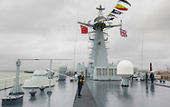 A general view of the top deck of the Chinese Naval assault ship Chang Bai Shan at Portsmouth Royal Navy Base today. The ship is involved in the first visit by the Chinese Navy to the UK since 2007 and the largest ever. She is accompanied by the frigate Yun Cheng (in the background) and the replenishment ship Chaohu. The ships arrived in Portsmouth 24 hours early due to the expected bad weather. The Royal Navy statement stated that the five day formal visit is aimed at enhancing military understanding between the UK and China. Picture date Monday 12th January, 2015.<br /> Picture by Christopher Ison. Contact +447544 044177 chris@christopherison.com