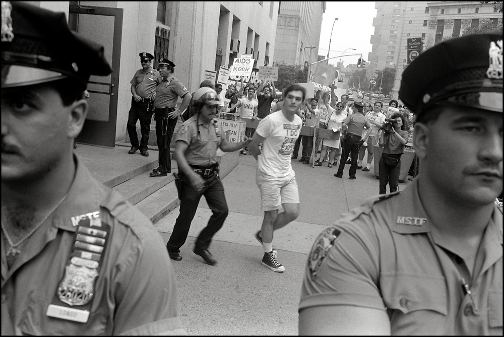 Jim Eigo was arrested after several ACT UP members staged a sit-in in the offices of Stephen Joseph, the New York City Commissioner of Health,  as others demonstrated outside, after Joseph had suddenly halved the number of estimated AIDS cases in NYC, on July 19th, 1988 - a move that threatened to drastically reduce funding for AIDS services.
