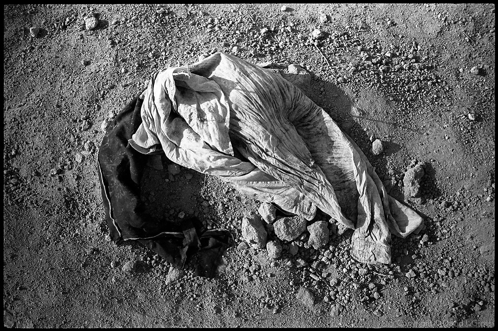 The clothing, documents, and remains of the bodies dug up at the mass grave near Hillah, Iraq, were put into plastic bags and left out for people to search as they tried to find their missing relatives. Plastic bags are a bad way to store such evidence, since the trapped moisture causes poisonous molds to grow. However, those in charge, Iraqis and Americans, paid no heed to advice from the specialists.