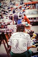 Street Vendor, Ecuador, man wearing t-shirt with US dollar imprint design.