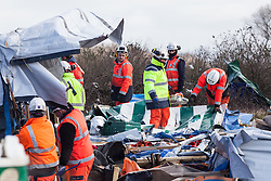 Licensed to London News Pictures. 03/03/2016. Contractors work to dismantle and clear the makeshift shelters in which thousands have lived through the winter. French authorities are clearing the southern half of the Calais 'Jungle' camp, which charities estimate to contain 3,500 people. Photo credit : Rob Pinney/LNP