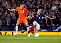 Football<br /> 09/09/2009 SCOTLAND V NETHERLANDS: <br /> ALAN HUTTON  (SCO) TACKLES ARJEN ROBBEN  DURING THE 2010 WORLD CUP QUALIFIER AT HAMPDEN PARK, GLASGOW.<br /> Credit: Colorsport