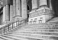 Steps and empty chairs at the New York Public Library on 42nd street and Fifth Avenue.