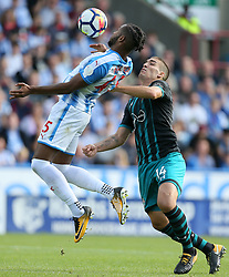 Huddersfield Town's Kasey Palmer (left) and Southampton's Oriol Romeu battle for the ball during the Premier League match at the John Smith's Stadium, Huddersfield.