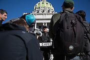 Harry Hughes of the NSM Arizona District talks to reporters in front of the Pennsylvania State Capitol.