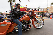 Leather clad bikers ride down Main Street during the 74th Annual Daytona Bike Week March 7, 2015 in Daytona Beach, Florida.