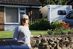 Woman outside bungalow