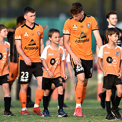 BRISBANE, AUSTRALIA - NOVEMBER 7: Kai Trewin and Dylan Wenzel-Halls of the Roar enter the field during the friendly match between Eastern Suburbs FC and Brisbane Roar FC at Heath Park on November 7, 2020 in Brisbane, Australia. (Photo by Patrick Kearney)