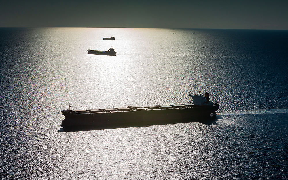 Ore carriers wait out side of Port Hedland waiting for their turn to enter the port and load iron ore.