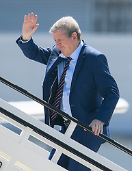 © Licensed to London News Pictures. 06/06/2016. Luton, UK. England manager ROY HODGSON joins other members of England national football squad as they board a plane at Luton airport in Bedfordshire, England, to head for their training camp in France, ahead of the start of the UEFA Euro 2016 championships.  Photo credit: Ben Cawthra/LNP
