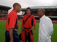 Sylvian Wiltord, Arsenal's new signing, with new teammates Thierry Henry (left) and Robert Pires . Arsenal v Charlton Athletic, 26/8/00. Credit: Colorsport / Andrew Cowie.