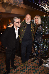 David Downton, Sam McKnight and Virginia Bates at reception to celebrate the launch of the Claridge's Christmas Tree 2017 at Claridge's Hotel, Brook Street, London England. 28 November 2017.