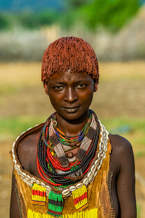 A Hamer tribe woman with elaborate beaded jewelry, Omo Valley, Ethiopia.