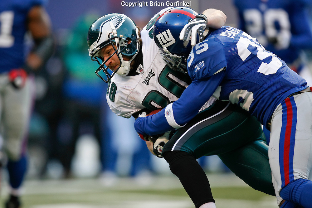 11 Jan 2009: Philadelphia Eagles wide receiver Kevin Curtis #80 is tackled by New York Giants cornerback Kevin Dockery #35 during the game against the New York Giants on January 11th, 2009.  The  Eagles won 23-11 at Giants Stadium in East Rutherford, New Jersey.