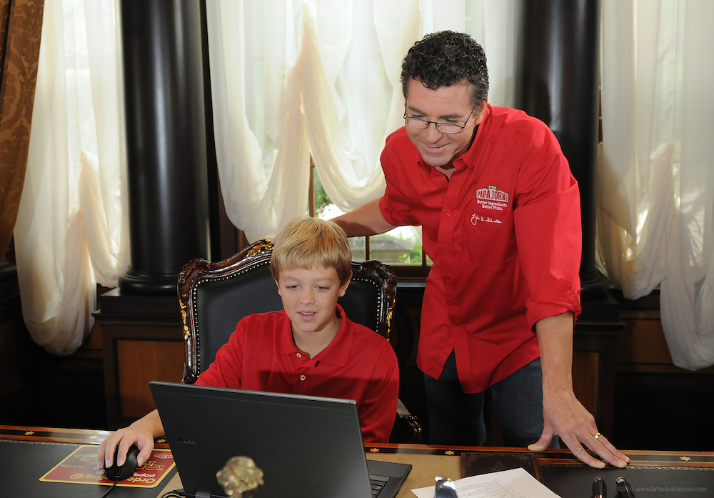 John Schnatter, founder of Papa John's, gets a hand from his 12 year-old son, Beau, in placing his first-ever online order to help mark the rollout of the company's revamped website. Papa John's was the first pizza company to introduce online ordering in 2001 at www.papajohns.com and the brand has since transacted more than $2 billion in online sales. Schnatter started the business in the broom closet of his father's tavern 26 years ago and the company has grown to be the world's third largest pizza chain. Until last week, he had never ordered a pizza online. Schnatter's order, made from his home in Louisville, Ky., can be watched on www.facebook.com/papajohns.