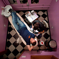 """(DAYIN) Aberdeen 1/8/2003  Sean Bergin of Aberdeen sits in one of the chairs at Fat Cat's Tattoo shop where he gets his 9th tattoo a second performed by tattoo artist Spencer Muller AKA """"Ponkin"""" of Cliffwood Beach who works at the shop.   Michael J. Treola Staff Photographer.......mjt"""