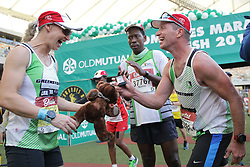 10062018 (Durban) Mark propose to his wife at the finnish line at the Mosses Mabhida stadium venue during the Comrades Marathon on Sunday as Bong'musa Mthembu and Ann Ashworth ensured that the coveted titles remained on these shores.<br /> Picture: Motshwari Mofokeng/African News Agency/ANA