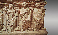 """Roman relief sculpted sarcophagus of Domitias Julianus and Domita Philiska, 2nd century AD, Perge. Antalya Archaeology Museum, Turkey.<br /> <br /> it is from the group of tombs classified as. """"Columned Sarcophagi of Asia Minor"""". <br /> The lid of the sarcophagus is sculpted into the form of a """"Kline"""" style Roman couch on which lie Julianus &  Philiska. This type of Sarcophagus is also known as a Sydemara Type of Tomb. Against a grey background..<br /> <br /> If you prefer to buy from our ALAMY STOCK LIBRARY page at https://www.alamy.com/portfolio/paul-williams-funkystock/greco-roman-sculptures.html . Type -    Antalya    - into LOWER SEARCH WITHIN GALLERY box - Refine search by adding a subject, place, background colour, etc.<br /> <br /> Visit our ROMAN WORLD PHOTO COLLECTIONS for more photos to download or buy as wall art prints https://funkystock.photoshelter.com/gallery-collection/The-Romans-Art-Artefacts-Antiquities-Historic-Sites-Pictures-Images/C0000r2uLJJo9_s0"""