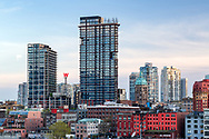 Buildings of Vancouver's Gastown and the Downtown Eastisde as photographed from Canada Place in Vancouver, British Columbia, Canada.  The two towers in the middle/left are the Woodward's development completed in 2010.  The older, shorter tower in the middle right is the Sun Tower.  The Sun Tower was completed in 1912 and at the time was known as the World Building and claimed to be the tallest building in the British Empire.