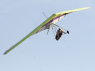 Ellenville, NY - Hang gliders and paragliders soar in the sky above Ellenville on May 30, 2009.