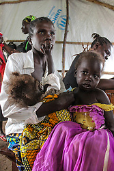 Children are medically screened at Kuluba reception centre on the border of South Sudan and Uganda before being taken to refugee settlements. More than 300,000 South Sudanese refugees have fled from the country's civil war into Uganda since fighting broke out in July. They mostly travel by foot for days through the bush as roads have been blocked or are too dangerous to cross. The massive influx of refugees has caused a strain in humanitarian aid due to large numbers and lack of funding. BidiBidi settlement is now the third largest in the world and holds more than 210,000 people since its opening in September.