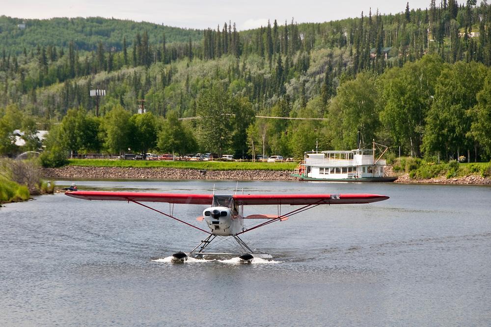 Alaska, Fairbanks. The Riverboat Discovery paddle-wheel tour along the Chena River gives tourists a taste of Alaskana.