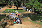 Tourists in the water gardens of Sigiriya rock palace, Central Province, Sri Lanka, Asia