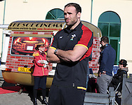 Jamie Roberts of Wales is interviewed for TV as he poses in front of a caravan cinema.Wales Rugby team announcement press conference at the Vale Resort, Hensol near Cardiff, South Wales on Wed 24th February 2016. The team are preparing for the the RBS Six nations championship match against France on Friday night.<br /> pic by  Andrew Orchard, Andrew Orchard sports photography.