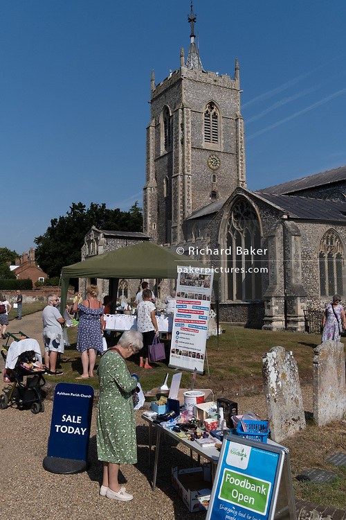 Members of the local parish community attend a churchyard market, an event helping raise funds outside the Church of St. Michael, on 10th August 2020, in Aylsham, Norfolk, England.